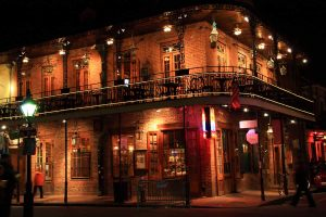 streets at night in the french quarter of new orleans